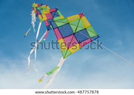 Colorful kites flying in blue sky