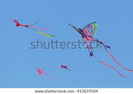 Colorful kites on Bondi Beach, Sydney, AU, 13th September 2015. The Festival of the Winds kite flying festival in Sydney's most famous beach Bondi. - stock photo