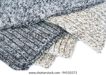 Colorful knitted cloth on white background. - stock photo