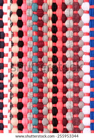 Colorful knitted cloth reuse Closeup of crochet rag rug  - stock photo