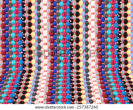 Colorful knitted cloth reuse Closeup of crochet rag rug with perspective effect. - stock photo