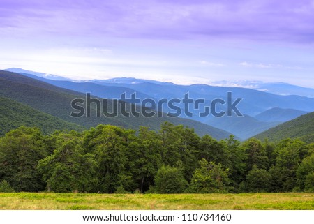 Colorful landscape over ridges of Carpathian Mountains in Ukraine - stock photo