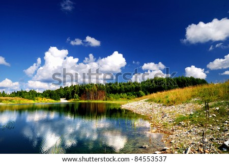 Colorful landscape with lake and forest. Latvia - stock photo