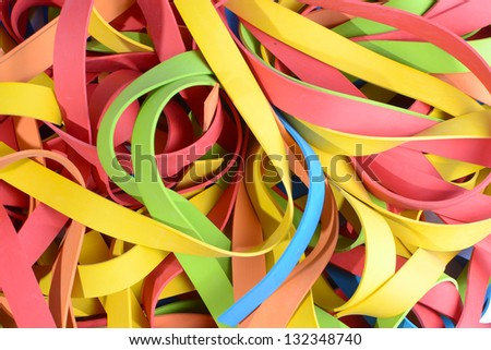 colorful large stack of rubber straps, strips closeup. - stock photo