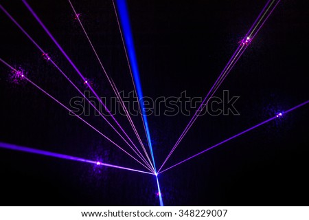 Colorful Laser effect over a plain black background.