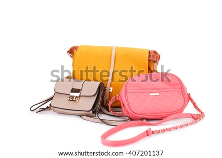 Colorful leather bags isolated on white background.