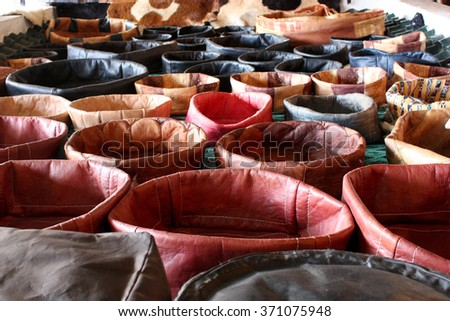 Colorful leather products for sale at Fez tannery, Morocco  - stock photo