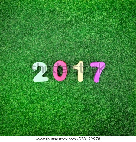 Colorful 2017 letter on artificial turf background - New year concept