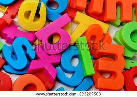 Colorful letters on background closeup