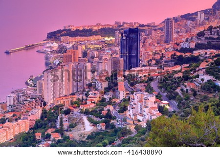 Colorful light on the sea and Monte Carlo town at dusk, Monaco, French Riviera - stock photo