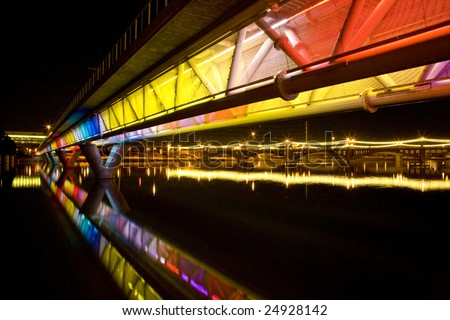 Colorful light rail bridge across the Salt  River in Tempe Arizona photographed at night. - stock photo