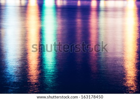 Colorful light reflect on the water - stock photo