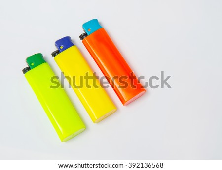 Colorful lighter isolated on a white canvas texture - stock photo