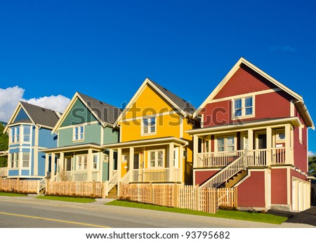 Colorful line of single homes in great neighborhood. The homes  in north America. Vancouver. - stock photo