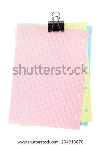 Colorful lined office paper with clip. Isolated on white background - stock photo