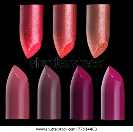 Colorful lipstick bullets isolated on black