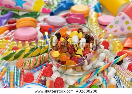 Colorful lollipop and candy on a white background - stock photo