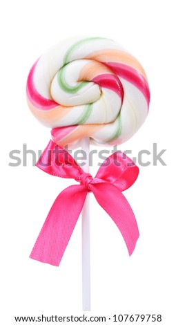 Colorful lollipop with bow isolated on white - stock photo