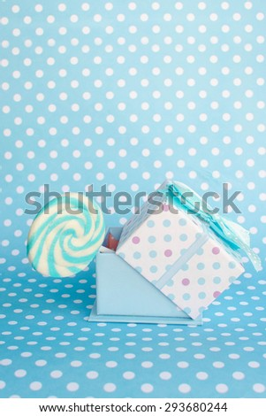 Colorful lollipop with gift - stock photo