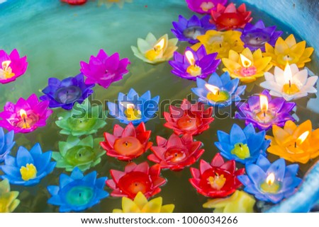 Colorful lotus flower burning candles floating stock photo royalty colorful lotus flower with burning candles are floating on the water to worship the buddha with mightylinksfo