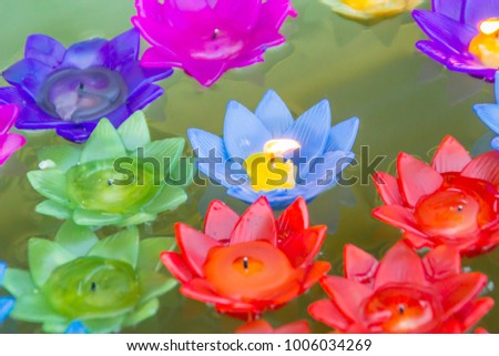 Colorful lotus flower burning candles floating stock photo colorful lotus flower with burning candles are floating on the water to worship the buddha with mightylinksfo Images