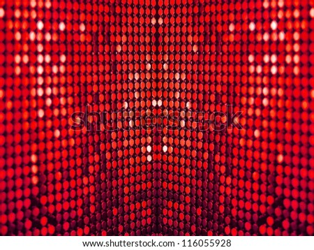 Colorful, luxurious, deep red sequins background. - stock photo