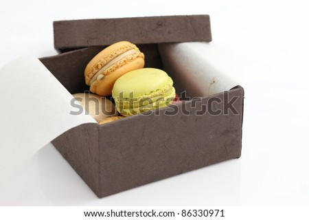Colorful Macaron in paper box isolated on white background - stock photo