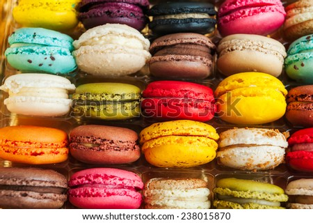 Colorful macarons in rows in a box, more than 20 flavors - stock photo