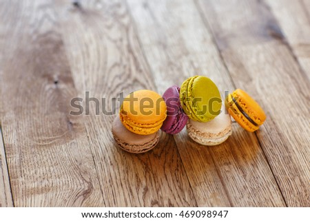 colorful macarons on dark  wood background