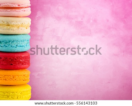 Colorful macarons on grung background