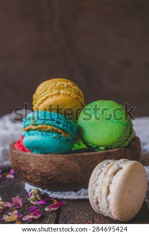 Colorful macaroon cookies in wooden bowl,selective focus and blank space