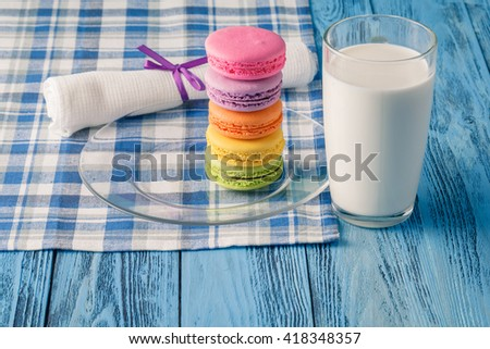 Colorful macaroons and glass of milk. Kid breakfast concept.