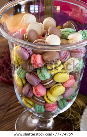 colorful macaroons in a big jar