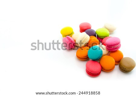 Colorful macaroons isolated on white background with copy space