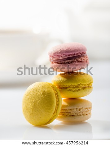 Colorful macaroons on background tea set - stock photo
