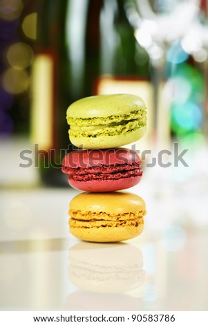 Colorful macaroons on Christmass tree background - stock photo