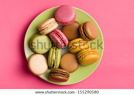 colorful macaroons on pink background - stock photo