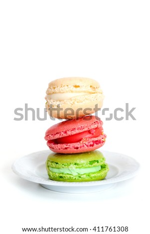 colorful macaroons on saucer - stock photo
