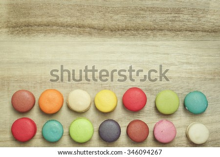 colorful macaroons on wooden background , top view