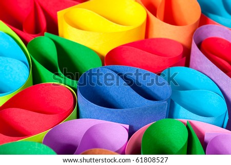 Colorful macro abstract of card stock in circular shapes. - stock photo