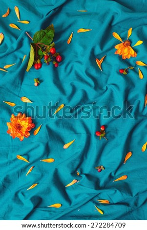 green bed sheets texture colorful bed colorful macro closeup background texture yellow flowers with green leaves petals red berries macro closeup background texture yellow stock photo
