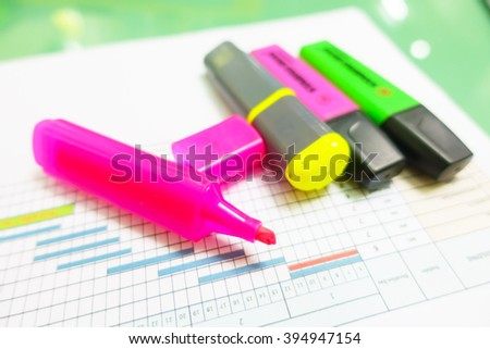 Colorful magic pen on schedule chart:Close up,select focus with shallow depth of field:Macro shot. - stock photo
