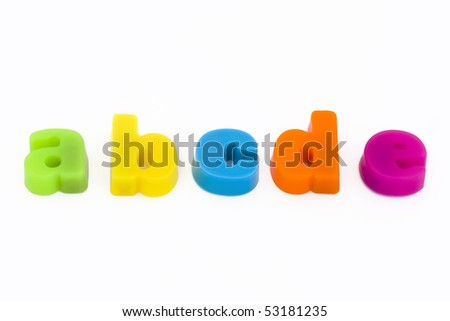 colorful magnetic fridge magnet letters on a white background - stock photo