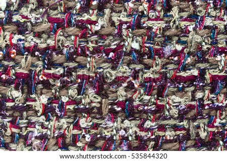 Colorful (main color red and green) hand weaving matting tweed fabric texture. Closeup horizontal fragment