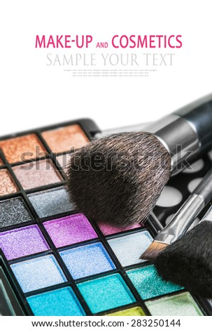 Colorful make-up and cosmetics isolated on a white background. Text example. Focus in the lower part of the frame on the blue shadows  - stock photo