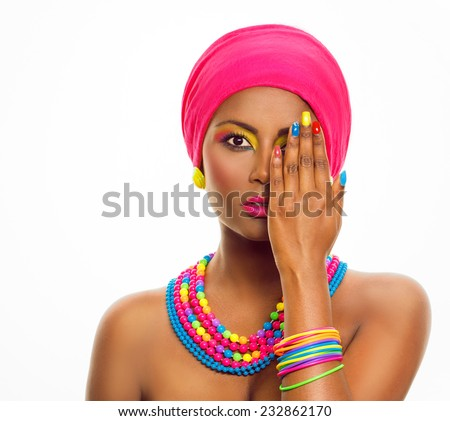 Colorful make up and manicure. African ethnic model with brown dark skin, headscarf and accessories. Beauty portrait, over white background, with copy space. - stock photo