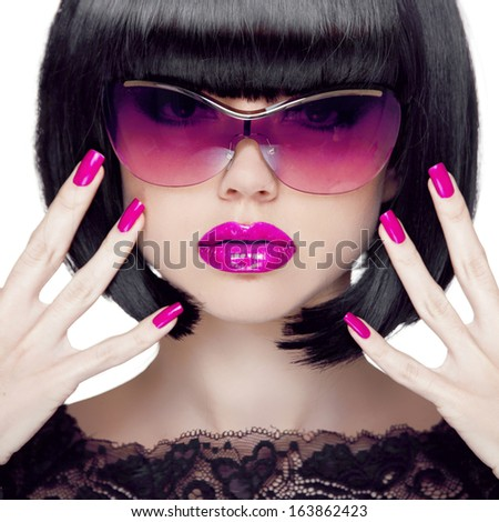 Colorful Make up. Closeup portrait. Purple sexy lips. Manicured polish nails. Luxury Brunette Woman wearing in Fashion Sunglasses. Black short hair style.