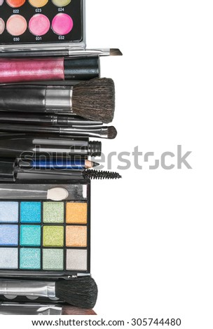 Colorful make-up products isolated on a white background - stock photo