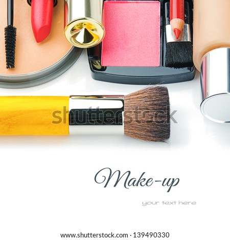 Colorful make-up products isolated over white - stock photo