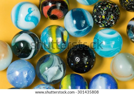 Colorful Marble Balls on Yellow background - stock photo